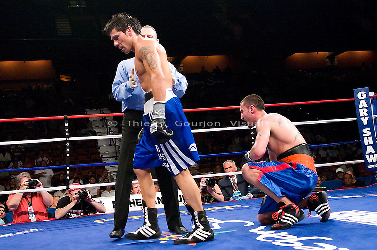Uncasville, CT - June 7th, 2008: Sergio Martinez (blue/white trunk) is sent to the neutral corner  corner during his 8 rounds Super Welterweight fight against Archak Termeliksetian at the Mohegan Sun Casino. Martinez won by tko in the 7th round. Photo by Thierry Gourjon.
