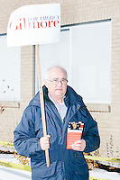 Lloyd Gatling, of Suffolk, Virginia, brother-in-law of former Virginia governor and Republican presidential candidate Jim Gilmore holds campaign signs for the candidate outside the polling location for Manchester Ward 2 at Hillside Middle School in Manchester, New Hampshire, on the day of primary voting, Feb. 9, 2016. Gilmore finished in last place among major Republican candidates still in the race with a total of 150 votes.