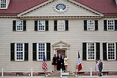 U.S. First Lady Melania Trump, from left, U.S. President Donald Trump, Emmanuel Macron, France's president, and Brigitte Macron, France's first lady, stand for photographers outside the Mansion at the Mount Vernon estate of first U.S. President George Washington in Mount Vernon, Virginia, U.S., on Monday, April 23, 2018. As Macron arrives for the first state visit of Trump's presidency, the U.S. leader is threatening to upend the global trading system with tariffs on China, maybe Europe too. <br /> Credit: Andrew Harrer / Pool via CNP