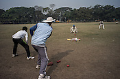 Balram Singh (2nd from left) coaches young cricketers from the Calcutta Parsee Club during their regular practice session at the maidan in Kolkata, West Bengal, India.