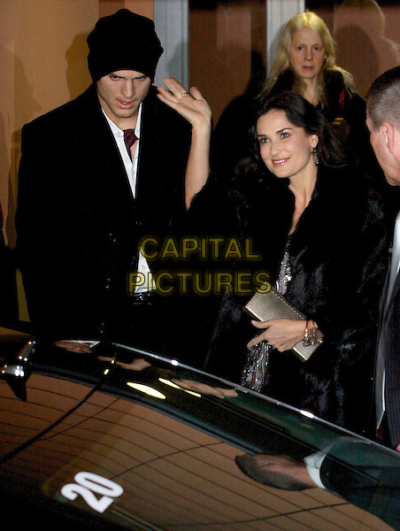 "ASHTON KUTCHER & DEMI MOORE.On their way to ""Happy Tears"" Film Premiere during the Berlinale 2009 59th International Berlin Film Festival in Berlin, Germany, 11th February 2009..half length hat black fur coat beaded silver dress husband wife hand waving .CAP/PPG.©Jens Hartmann/People PIcture/Capital Pictures"