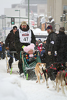 Kirk Barnum leaves the 2011 Iditarod ceremonial start line in downtown Anchorage, during the 2012 Iditarod..Jim R. Kohl/Iditarodphotos.com