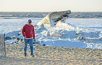 A man walks near the frozen Delaware Bay near the SS Atlantus sunken ship Friday, January 05, 2018 in Cape May Point, New Jersey. (Photo by William Thomas Cain/Cain Images)