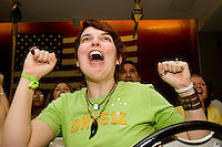Brazil fan Marilia Vieire cheers on her team in a match against Australia on June 18, 2006 at the Emporium, a restaurant in a section of New York City known as &quot;Little Brazil&quot;.<br /> <br /> The World Cup, held every four years in different locales, is the world's pre-eminent sports tournament in the world's most popular sport, soccer (or football, as most of the world calls it).  Qualification for the World Cup is open to any country with a national team accredited by FIFA, world soccer's governing body. The first World Cup, organized by FIFA in response to the popularity of the first Olympic Games' soccer tournaments, was held in 1930 in Uruguay and was participated in by 13 nations.    <br /> <br /> As of 2010 there are 208 such teams.  The final field of the World Cup is narrowed down to 32 national teams in the three years preceding the tournament, with each region of the world allotted a specific number of spots.  <br /> <br /> The World Cup is the most widely regularly watched event in the world, with soccer teams being a source of national pride.  In most nations, the whole country is at a standstill when their team is playing in the tournament, everyone's eyes glued to their televisions or their ears to the radio, to see if their team will prevail.  While the United States in general is a conspicuous exception to the grip of World Cup fever there is one city that is a rather large exception to that rule.  In New York City, the most diverse city in a nation of immigrants, the melting pot that is America is on full display as fans of all nations gather in all possible venues to watch their teams and celebrate where they have come from.