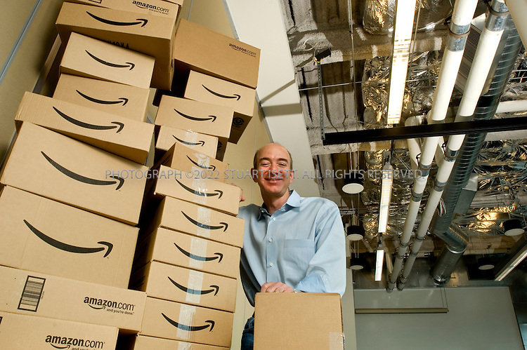 4/24/2007--Seattle, WA, USA..Jeff Bezos, CEO of Amazon.com posing with Amazon delivery boxes at the company's headquarters in Seattle, WA....Photograph ©2007 Stuart Isett.All rights reserved