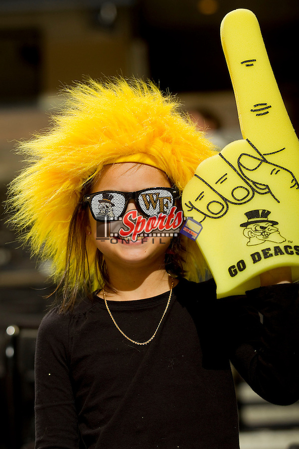 A young fan shows her support for the Wake Forest Demon Deacons as they played host to the North Carolina State Wolfpack at the LJVM Coliseum on January 6, 2013 in Winston-Salem, North Carolina.  The Demon Deacons defeated the Wolfpack 69-56.    (Brian Westerholt/Sports On Film)