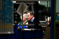 Wednesday 19 February 2014<br /> Pictured:Factory workers  talk with with Prime Minister David Cameron ( Centre )<br /> Re: Prime Minister David Cameron visitingthe  St David Assemblies factory  in St. Davids, Pembrokeshire, Wales
