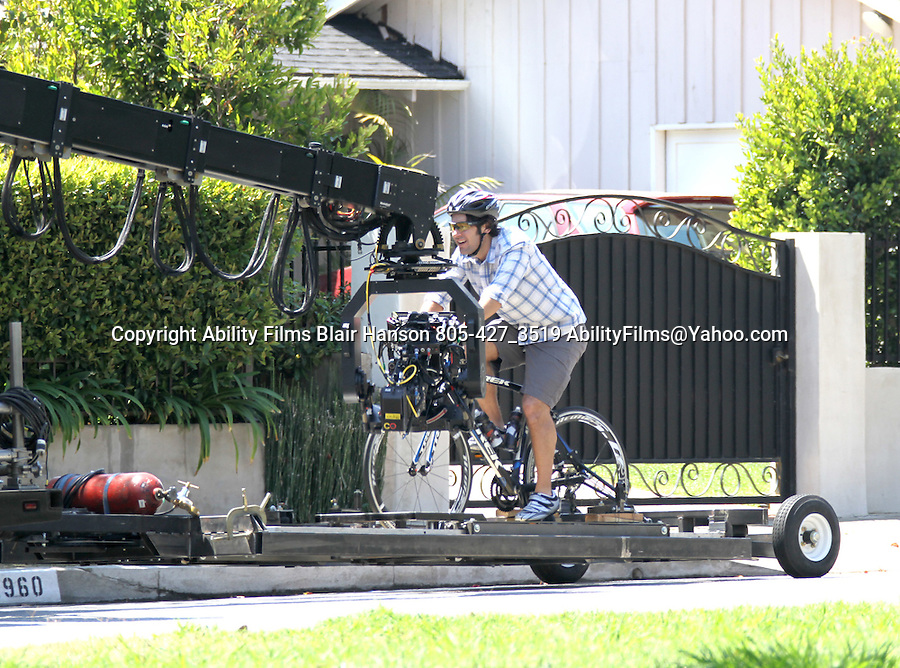 August 24th 2011 ..Paul Rudd riding a bicycle on the street while filming his new move This is Forty in Los Angeles. Leslie Mann driving with Paul in another scene...AbilityFilms@yahoo.com.805-427-3519.www.AbilityFilms.com.