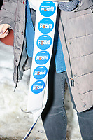 A volunteer hands out campaign stickers before a campaign event for Democratic presidential candidate and former Vice President Joe Biden at The Sports Barn in Hampton, New Hampshire, on Sun., December 8, 2019.
