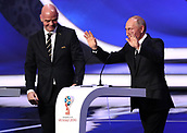1st December 2017, State Kremlin Palace, Moscow, Russia;  FIFA President Gianni Infantino (L) stands beside a speaking Russian President Vladimir Putin during the FIFA 2018 World Cup draw, at the State Kremlin Palace in Moscow, Russia