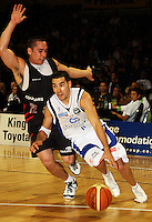 Saints guard Luke Martin goes past Luke Henare during the NBL match between the Wellington Saints and Christchurch Cougars at Te Rauparaha Stadium, Porirua, Wellington, New Zealand on Saturday 4 April 2009. Photo: Dave Lintott / lintottphoto.co.nz