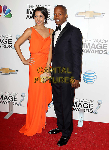 Corinne Foxx, Jamie Foxx.44th NAACP Image Awards held at the Shrine Auditorium,  Los Angeles, California, USA, 1st February 2013..full length orange dress suit tuxedo bow tie black hand on hip .CAP/ADM/KB.©Kevan Brooks/AdMedia/Capital Pictures.