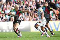 Matt Hopper of Harlequins looks to hand off Sam Tuitupou of Sale Sharks during the Aviva Premiership match between Harlequins and Sale Sharks at The Twickenham Stoop on Saturday 15th September 2012 (Photo by Rob Munro)