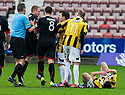 Pars' Andrew Geggan clashes with East Fife's Liam Buchanan (19)  after he reacts to Lewis Barr's late challenge from behind.