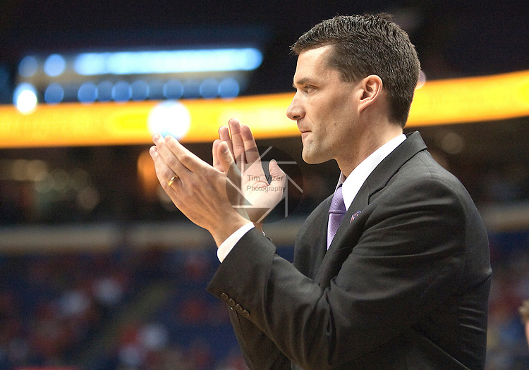 March 08 2009     Northern Iowa head coach Ben  Jacobson applauds a play by his team in the first half.  The Panthers of the University of Northern Iowa defeated the Redbirds of Illinois State University 60-57 in overtime in the championship game of the Missouri Valley Conference Tournament on Sunday March 8, 2009 at the Scottrade Center in downtown St. Louis, Missouri.   ..         *******EDITORIAL USE ONLY*******