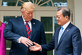 US President Donald J. Trump (L) and Korean President Moon Jae-in (R) shake hands in the Colonnade of the White House in Washington, DC, USA, 11 April 2019. President Moon is expected to ask President Trump to reduce sanctions on North Korea in an attempt to jump start nuclear negotiations between North Korea and the US.<br /> Credit: Jim LoScalzo / Pool via CNP