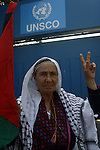 A Palestinian woman raises the victory sign and waving the national flag during a demonstration in support of Palestinian leader Mahmud Abbas' bid for statehood recognition at the United Nations on September 22, 2011 in Gaza City.  Photo by Mahmud Nassar