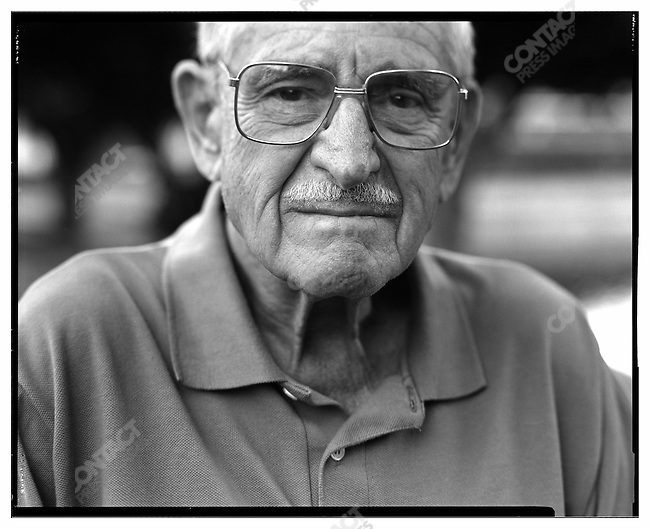 Former 116th Infantry Regiment flame thrower HARRY PARLEY. Posing at the back yard of his house: Parley was in the first wave of troops going ashore at Omaha Beach in June 6, 1944 during the D-Day invasion of Europe. Delray Beach, FL,  May 11, 2004