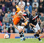 Gary Mackay-Steven gets launched by Kevin McBride of Dundee