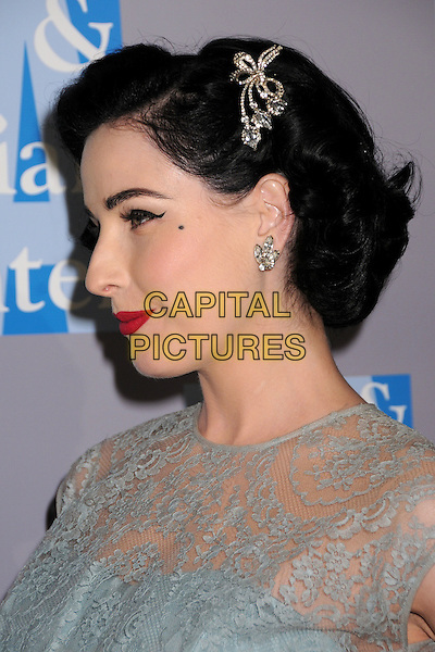 DITA VON TEESE.An Evening With Women: Celebrating Art, Music & Equality held at the Beverly Hilton Hotel, Beverly Hills, CA, USA..April 24th, 2009.headshot portrait pale blue green lace sleeveless fifties style forties sheer hair clip beauty spot diamante earring red lipstick profile.CAP/ADM/BP.©Byron Purvis/AdMedia/Capital Pictures.
