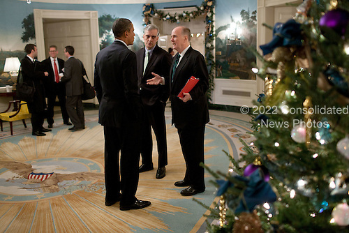 United States President Barack Obama talks with Deputy National Security Advisor Denis McDonough and National Security Advisor Tom Donilon in the Diplomatic Reception Room of the White House in Washington, D.C., before departing for Osawatomie, Kansas, December 6, 2011..Mandatory Credit: Pete Souza - White House via CNP