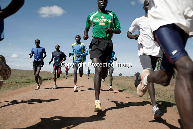 ELDORET, KENYA - MAY 19: Runners train on a rural road outside Eldoret. Some of the best runners in the world come from his highland area,  as the high elevation is good for training. (Photo by:  Per-Anders Pettersson)