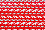 Colorful repeating abstract patterns in white and green wit red background.