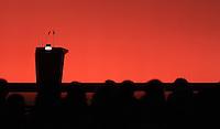 SPD Bundesparteitag im Congress Center Leipzig (CCL) an der Neuen Messe in Leipzig vom 14.11.-16.11.2013 - im Bild: Schattenriss des leeren Rednerpult mit leuchtendem SPD Logo. Foto: Norman Rembarz