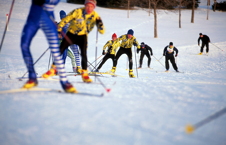 Skiers in motion during a Nordic shki race.