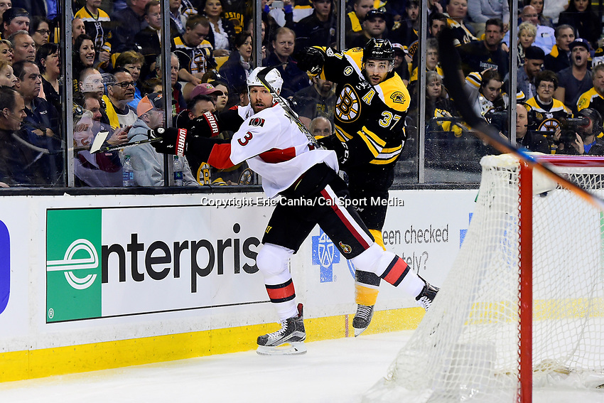 Monday, April 17, 2017: Boston Bruins center Patrice Bergeron (37) checks Ottawa Senators defenseman Marc Methot (3) during game 3 of round one of the National Hockey League Eastern Conference Stanley Cup Playoffs between the Ottawa Senators and the Boston Bruins, held at TD Garden, in Boston, Mass. Ottawa defeats Boston 4-3 in overtime and leads the series 2-1. Eric Canha/CSM