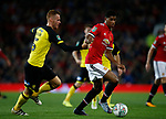 Tom Naylor of Burton Albion and Marcus Rashford of Manchester United during the Carabao Cup Third Round match at the Old Trafford Stadium, Manchester. Picture date 20th September 2017. Picture credit should read: Simon Bellis/Sportimage