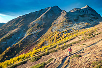 Trail running to the Wiwannihorn, a 3000 meter peak in Switzerland's Wallis region, climbing it and running out in the evening during fall colors.