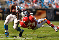 Carolina Panthers running back Jonathan Stewart (28) is tackled by Kansas City Chiefs FS Jarrad Page (44) during a NFL football game at Bank of America Stadium in Charlotte, NC.