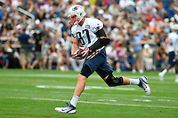July 24, 2014 - Foxborough, Massachusetts, U.S.- New England Patriots tight end Rob Gronkowski (87) lands with the ball during the New England Patriots training camp held at Gillette Stadium in Foxborough Massachusetts. Eric Canha/CSM
