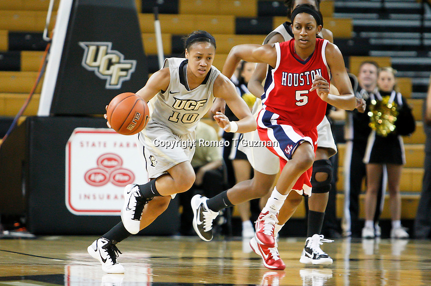 January 27, 2011: Houston forward Brittany Mason (5) chases Central Florida guard Aisha Patrick (10) on a fast break during first half womens Conference USA NCAA basketball game action between the Houston Cougars and the Central Florida Knights at the UCF Arena Orlando, Fl.