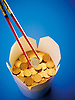 Pound coins in a takeaway noodle box with chop sticks