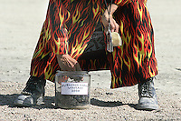 BLACK ROCK CITY,NV - AUGUST 31, 2008: The finale of the Burning Man event, August 31, 2008. Participants gather around the ashes of what was the 'Man' the night before, many collect melted scraps of the installation as a momento.