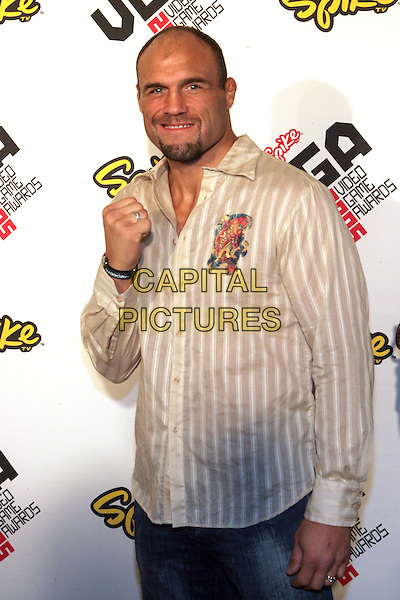 RANDY COUTURE.2005 Spike TV Video Game Awards - Arrivals held at the Gibson Amphitheater, Universal City, California..November 18th, 2005.Photo: Zach Lipp/AdMedia/Capital Pictures.Ref: Zl/ADM.half length fist hand gesture white striped shirt.www.capitalpictures.com.sales@capitalpictures.com.© Capital Pictures.