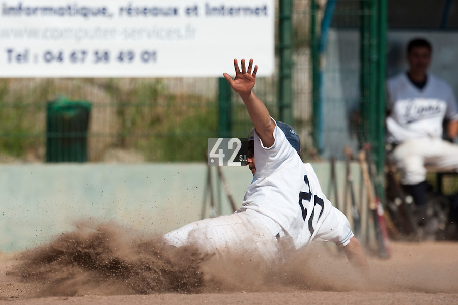 24 May 2009: Romain Scott-Martinez of Savigny slides safely into home plate during the 2009 challenge de France, a tournament with the best French baseball teams - all eight elite league clubs - to determine a spot in the European Cup next year, at Montpellier, France. Rouen wins 7-5 over Savigny.