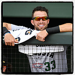 Left fielder T.J. Bennett (33) of the Augusta GreenJackets smiles as he waits for the start of a game against the Greenville Drive on Thursday, May 17, 2018, at Fluor Field at the West End in Greenville, South Carolina. Augusta won, 2-1. (Tom Priddy/Four Seam Images)