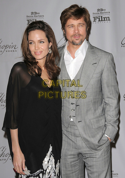 ANGELINA JOLIE & BRAD PITT.attend The 23rd Santa Barbara International Film Festival's Presentation of The Performance of the Year Award honoring Angelina Jolie held at The Arlington Theatre in Santa Barbara, California, USA, February 02 2008..half length grey gray suit jacket waistcoat black sheer dress shirt top couple.CAP/DVS.?Debbie VanStory/Capital Pictures
