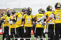October 31, 2009; Hamilton, ON, CAN;  Hamilton Tiger-Cats fullback Darcy Brown (24), wide receiver Corey Grant (8), linebacker Jamall Johnson (28), linebacker Otis Floyd (35). CFL football: Saskatchewan Roughriders vs. Hamilton Tiger-Cats at Ivor Wynne Stadium. The Tiger-Cats defeated the Roughriders 24-6. Mandatory Credit: Ron Scheffler. Copyright (c) 2009 Ron Scheffler.
