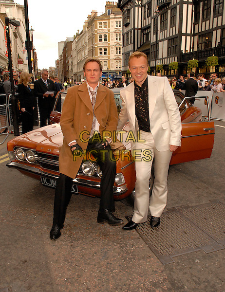 PHILIP GLENISTER & GRAHAM NORTON.Red Carpet Arrivals at The British Academy Television Awards (BAFTA) Sponsored by Pioneer, held at the London Palladium, London, England, May 20th 2007..full length grey silver suit funny phillip car from Life On MArs brown coat seventies style 70's.CAP/FIN.©Steve Finn/Capital Pictures.