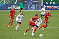 Portland, OR - Saturday, May 21, 2016: Portland Thorns FC forward Christine Sinclair (12) is chased by Washington Spirit forward Diana Matheson (8). The Portland Thorns FC defeated the Washington Spirit 4-1 during a regular season National Women's Soccer League (NWSL) match at Providence Park.