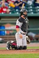 Wisconsin Timber Rattlers catcher Clint Coulter (12) on defense against the Great Lakes Loons at the Dow Diamond on May 4, 2013 in Midland, Michigan.  The Timber Rattlers defeated the Loons 6-4.  (Brian Westerholt/Four Seam Images)