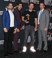 LOS ANGELES, CA, USA - APRIL 13: Jerry Ferrara, Adrian Grenier, Mark Wahlberg, Kevin Dillon in the press room at the 2014 MTV Movie Awards held at Nokia Theatre L.A. Live on April 13, 2014 in Los Angeles, California, United States. (Photo by Xavier Collin/Celebrity Monitor)
