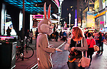 "NewYork, United States, October 07, 2011..A man dressed as ""Bugs Bunny"" ask for money after posing for a picture in Times Square in central Manhattan New York October 7, 2011. VIEWpress / Kena Betancur. .On the 20th day of the ""Occupy Wall Street"" protest, Mayor Michael Bloomberg weighed in on the movement. He mostly criticized the group and said their actions are hurting the economy and tourism sector..Local Media Report."