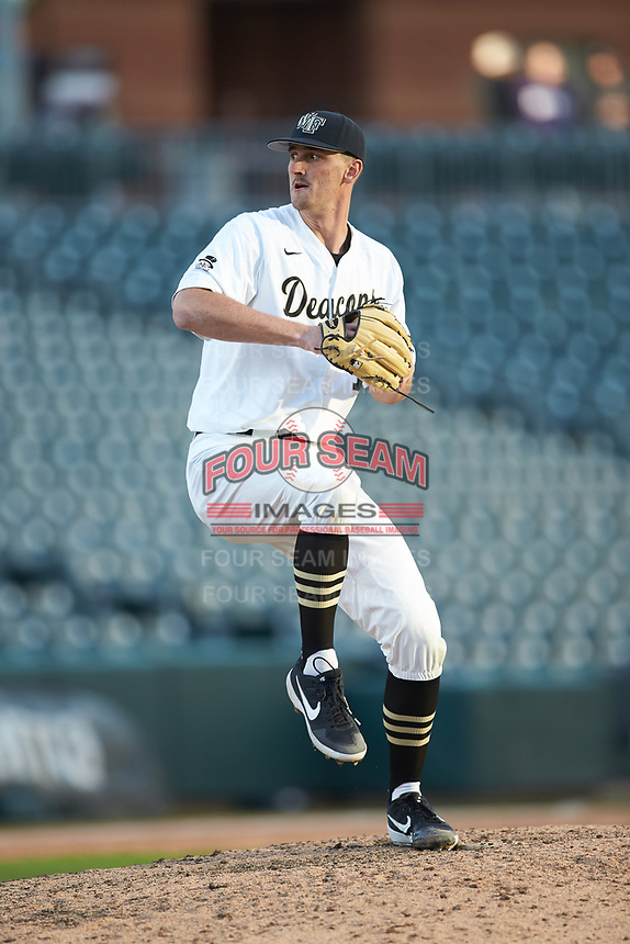 Wake Forest Demon Deacons relief pitcher Carter Bach (18) in action against the Furman Paladins at BB&T BallPark on March 2, 2019 in Charlotte, North Carolina. The Demon Deacons defeated the Paladins 13-7. (Brian Westerholt/Four Seam Images)