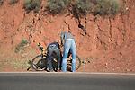Two men fixing bicycle, Atlas Mountains, Morocco