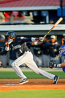 Raysheron Michel (1) of the Pulaski Mariners follows through on his swing against the Burlington Royals at Burlington Athletic Park on June20 2013 in Burlington, North Carolina.  The Royals defeated the Mariners 2-1 in 13 innings.  (Brian Westerholt/Four Seam Images)